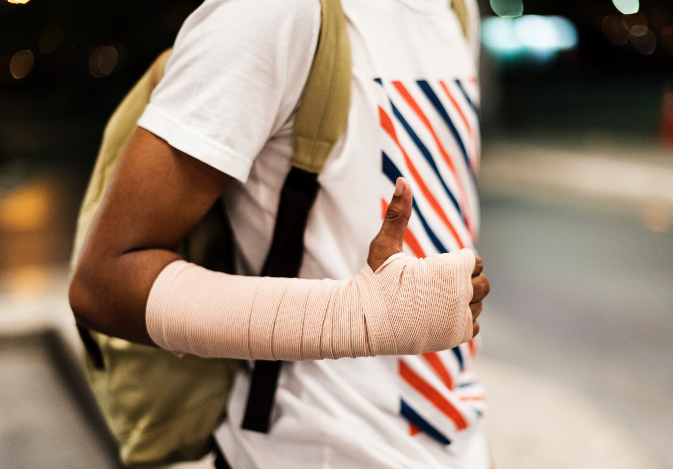 Man with wrapped arm