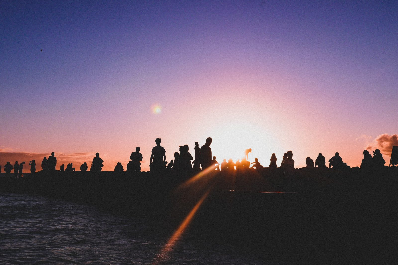 A crowd at sunset